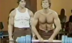Arnold Shows Bill Boggs How To Exercise Image